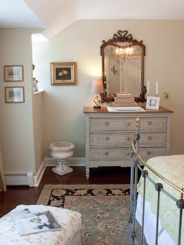 Inspiration for a timeless dark wood floor bedroom remodel in Boston with beige walls