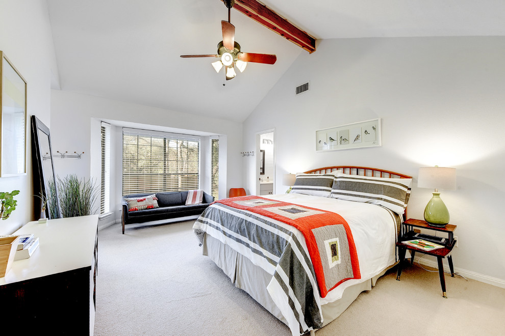 Inspiration for a transitional guest carpeted and beige floor bedroom remodel in Austin with white walls