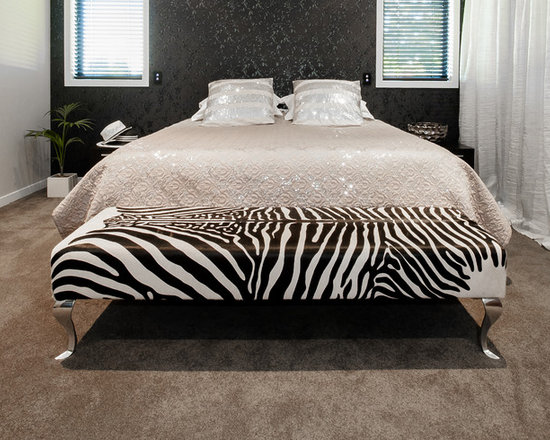 Gorgeous Creatures New Zealand - Zebra print cowhide ottoman for end of bed - A long rectangle zebra print cowhide ottoman 160cm x 50cm x 42cm tall with aluminium Queen Anne legs. This gorgeous ottoman looked amazing in several different rooms in the clients home.