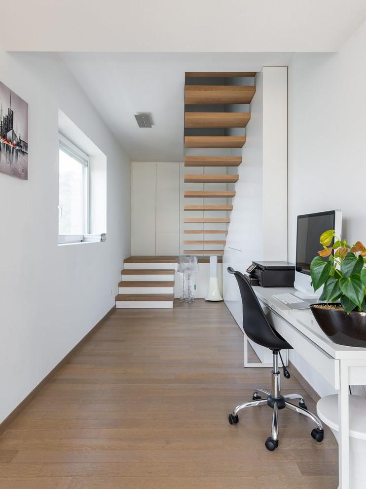 Study room - mid-sized scandinavian freestanding desk medium tone wood floor study room idea in Lyon with white walls