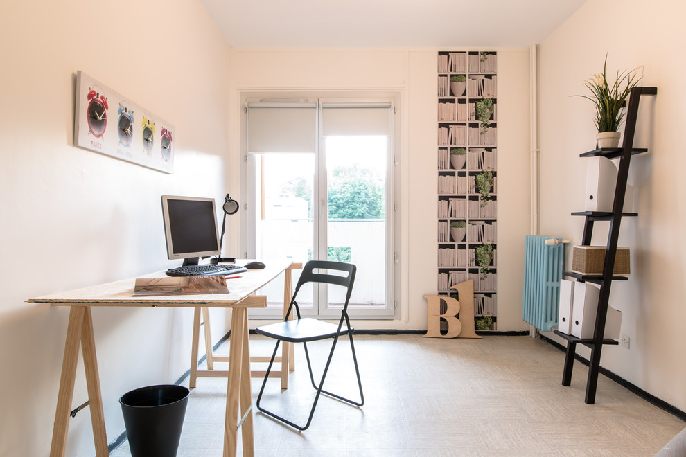 Mid-sized danish freestanding desk study room photo in Lyon with white walls