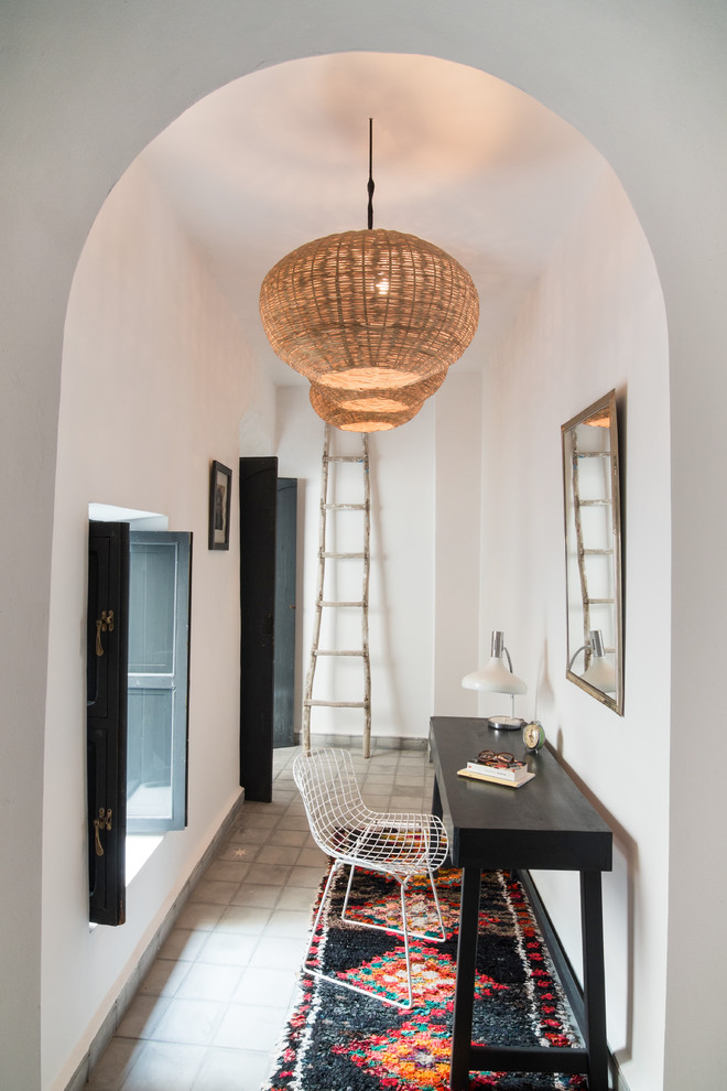 Tuscan freestanding desk gray floor study room photo in Marseille with white walls