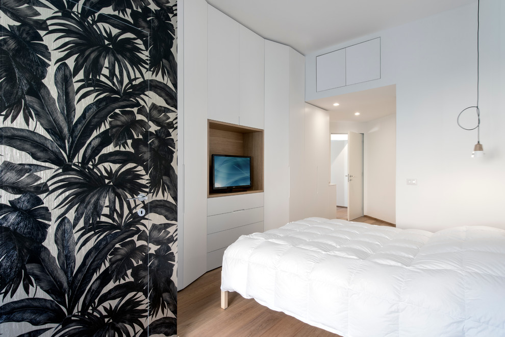 Bedroom - mid-sized contemporary master light wood floor bedroom idea in Milan with white walls