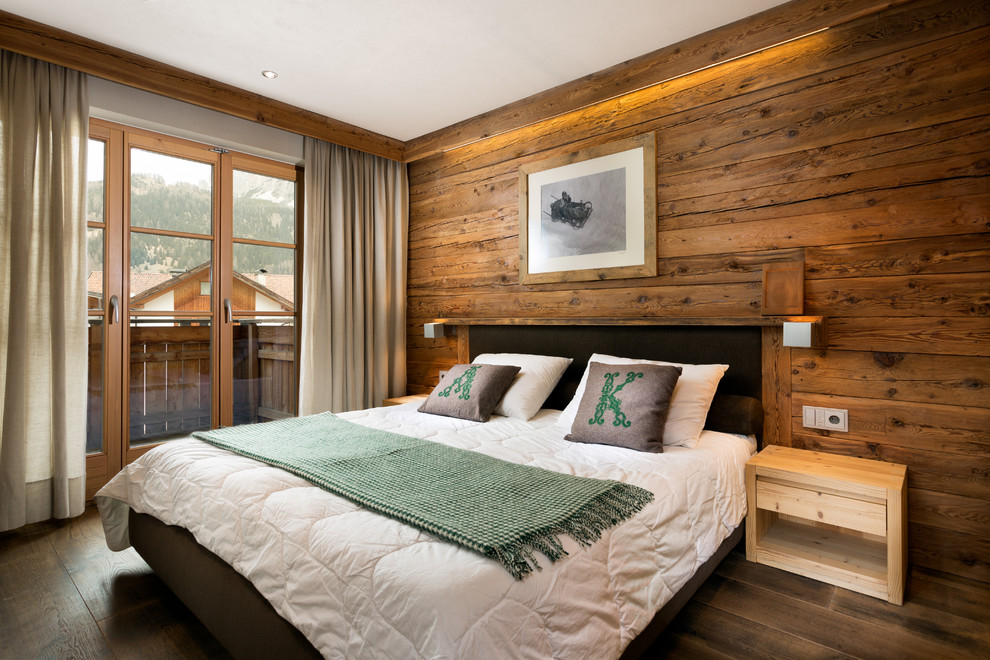 Mid-sized mountain style master dark wood floor bedroom photo in Venice with brown walls