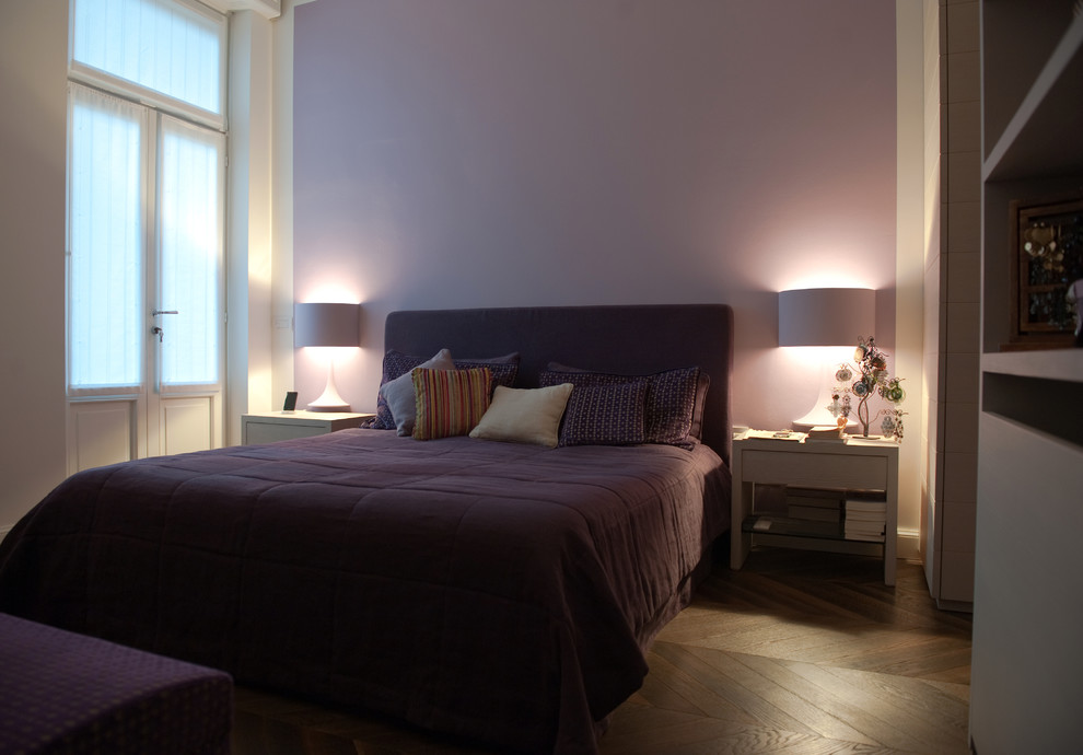 Large minimalist master dark wood floor and brown floor bedroom photo in Milan with purple walls and no fireplace