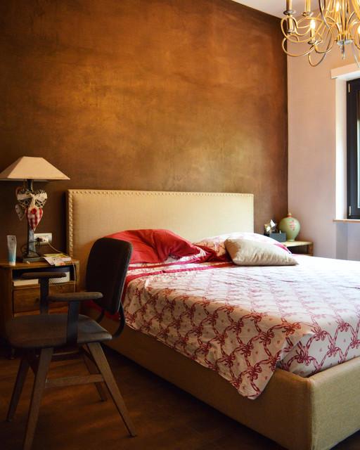 Immagine di una camera da letto boho chic