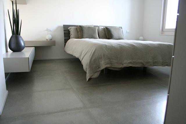 Gres porcellanato effetto cemento cerato contemporaneo camera da