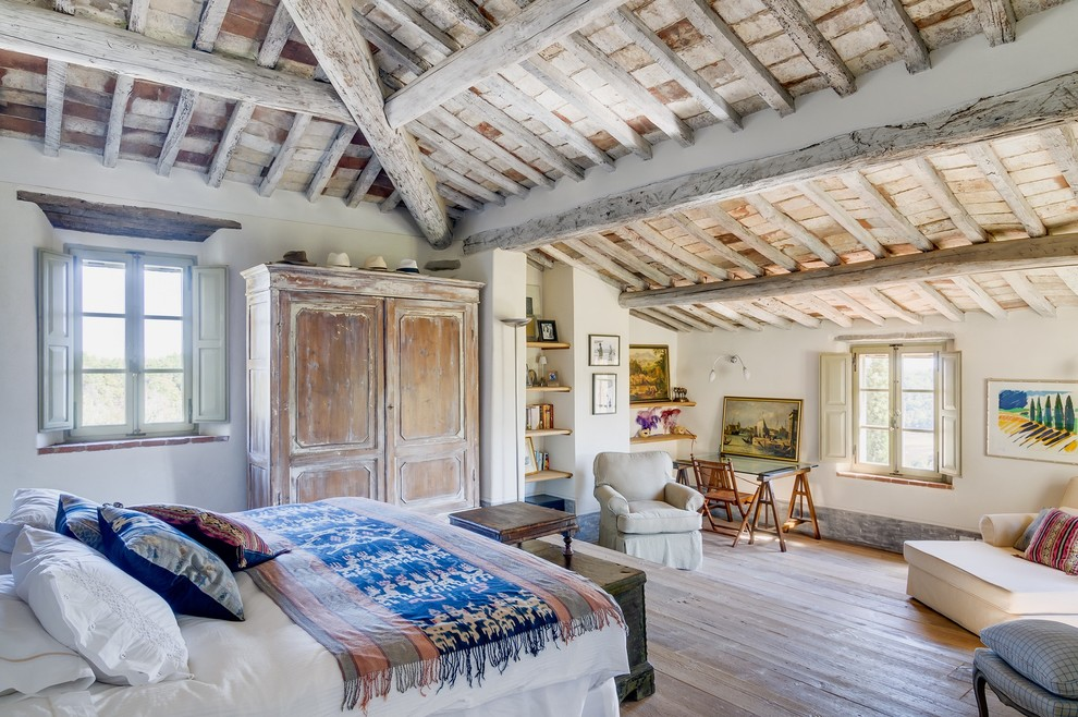Inspiration for a huge farmhouse master light wood floor bedroom remodel in Other with white walls