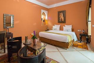 Camera da letto con pareti arancioni - Design, Foto e Idee ...