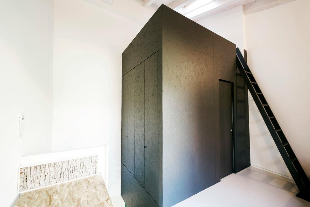 Idee per una piccola camera da letto stile loft minimal con pareti bianche e pavimento grigio