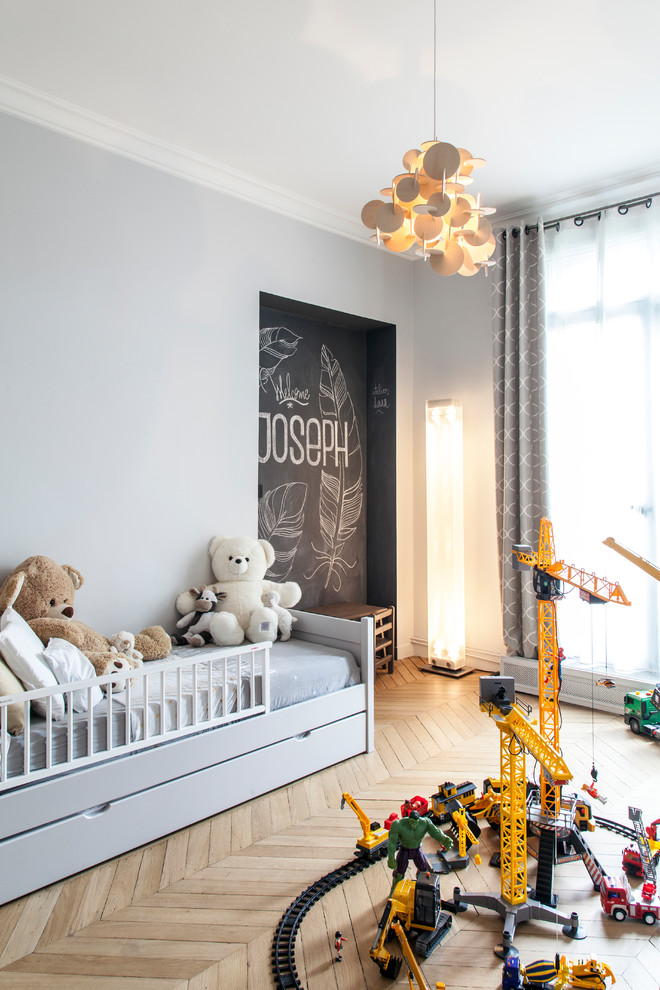 Inspiration for a contemporary gender-neutral brown floor kids' room remodel in Paris with gray walls