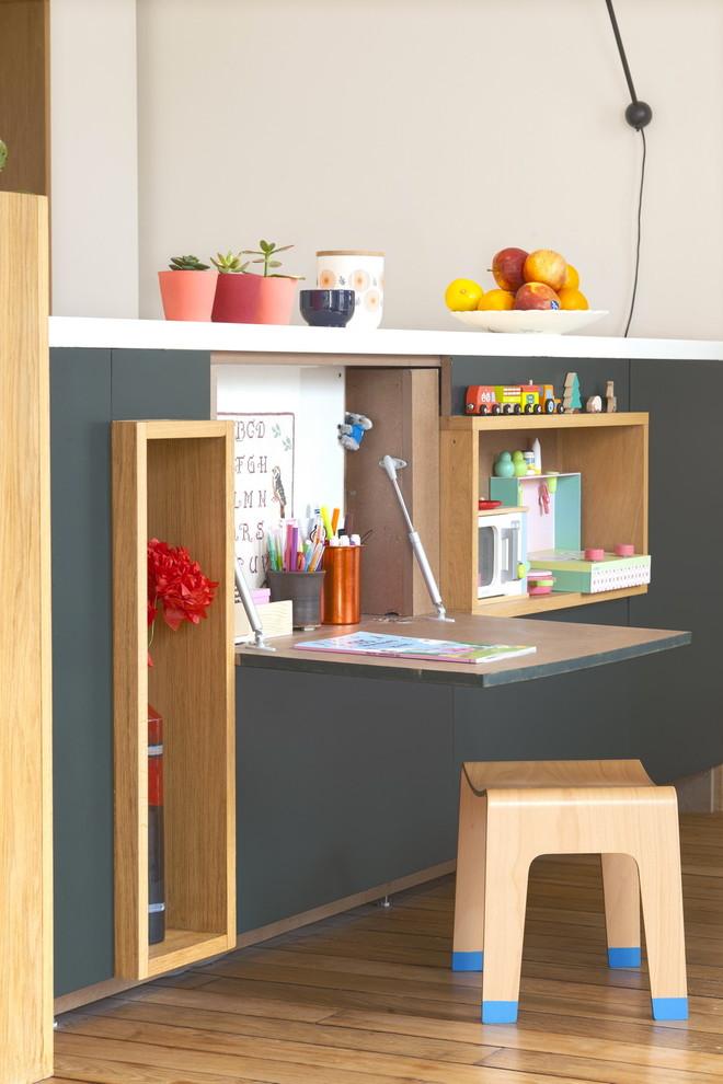 Inspiration for a scandinavian medium tone wood floor kids' room remodel in Paris with gray walls