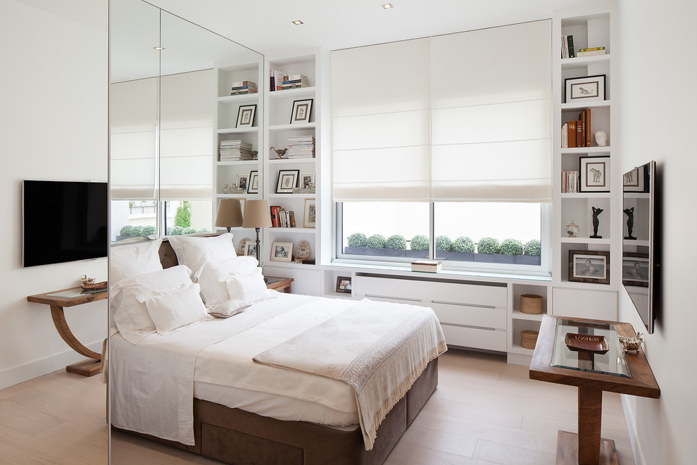 Bedroom - mid-sized contemporary master light wood floor bedroom idea in Paris with white walls