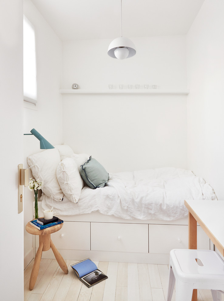 Small danish master light wood floor bedroom photo in Paris with white walls and no fireplace