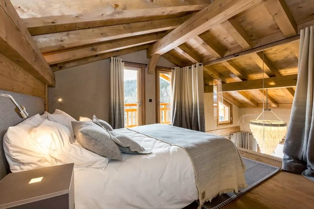 This Is An Example Of A Small Country Loft Style Bedroom In Lyon With Beige