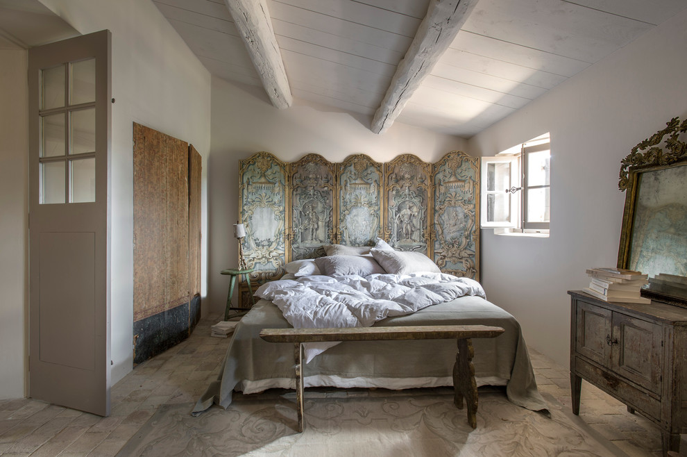 Example of a mid-sized country master brick floor bedroom design in Nice with white walls
