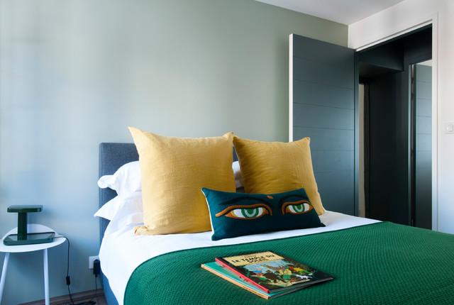 Example of a coastal bedroom design in Other