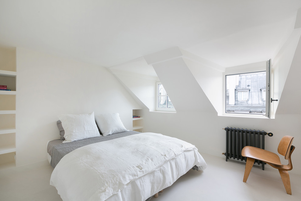 Bedroom - modern white floor bedroom idea in Other with white walls and no fireplace