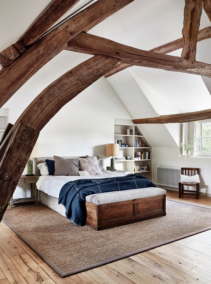 Bedroom - large farmhouse light wood floor bedroom idea in Paris with white walls