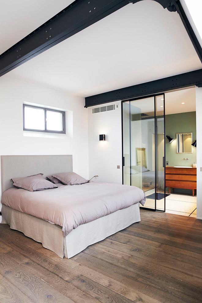 Immagine di una camera da letto industriale