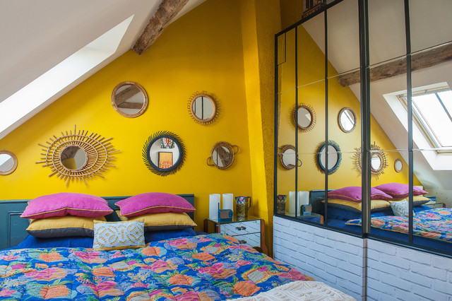 Inspiration for an eclectic bedroom remodel in Paris with yellow walls