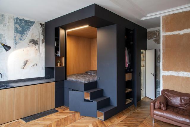 Une chambre contemporaine dans un studio à Strasbourg-Saint-Denis