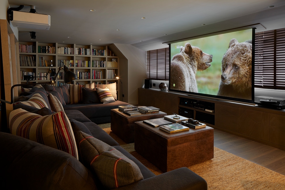 Home theater - large contemporary enclosed home theater idea in Barcelona with a projector screen and gray walls