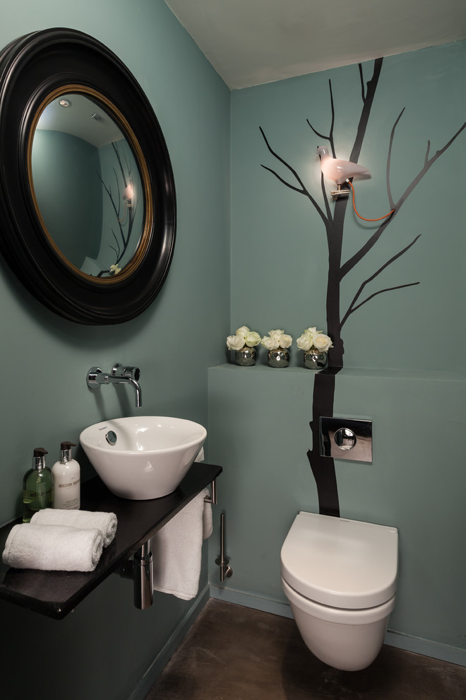 Trendy powder room photo in Other with a vessel sink and blue walls