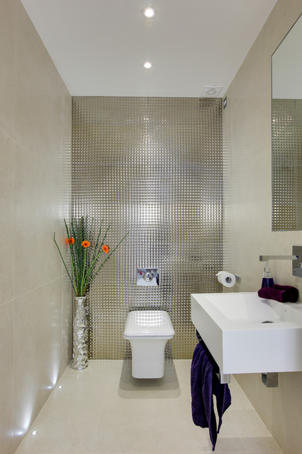 Photo of a small contemporary cloakroom in Hertfordshire with a wall-mounted sink, a wall mounted toilet, porcelain flooring and metal tiles.