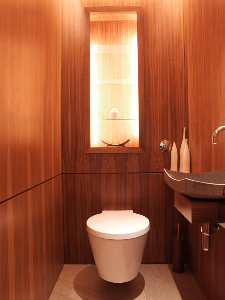 Example of a trendy powder room design in London