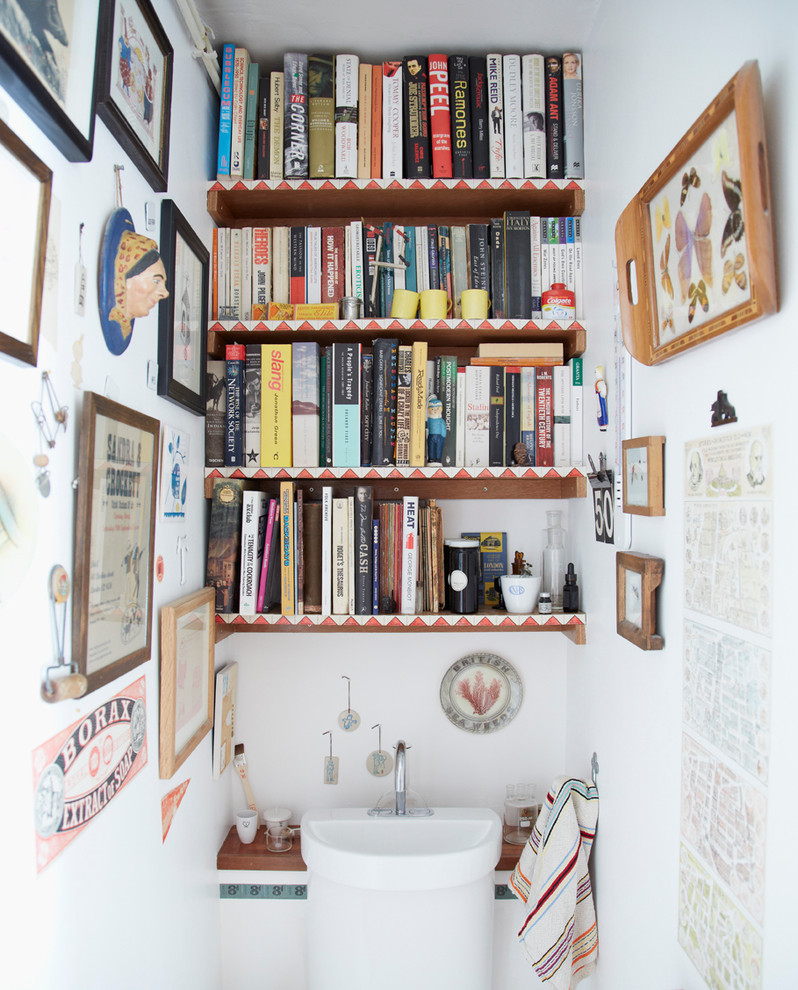 Small eclectic powder room photo in London