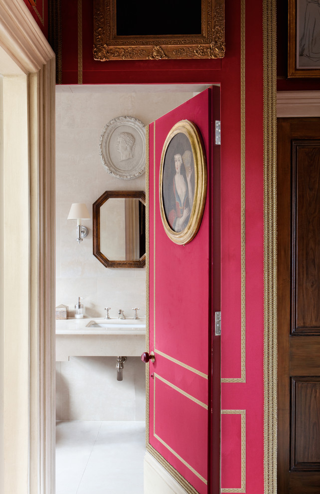 Example of a classic powder room design in London with an undermount sink and beige walls