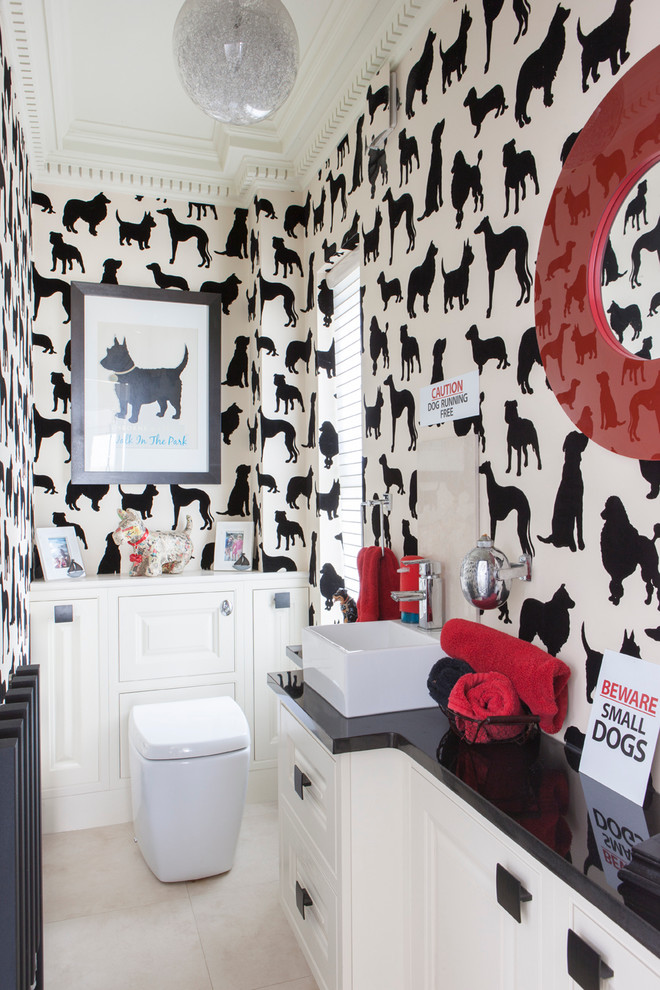 Eclectic powder room photo in Kent with a vessel sink