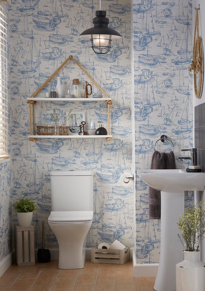 Small beach style gray tile, orange tile and porcelain tile ceramic tile powder room photo in Hampshire with a one-piece toilet, blue walls and a pedestal sink
