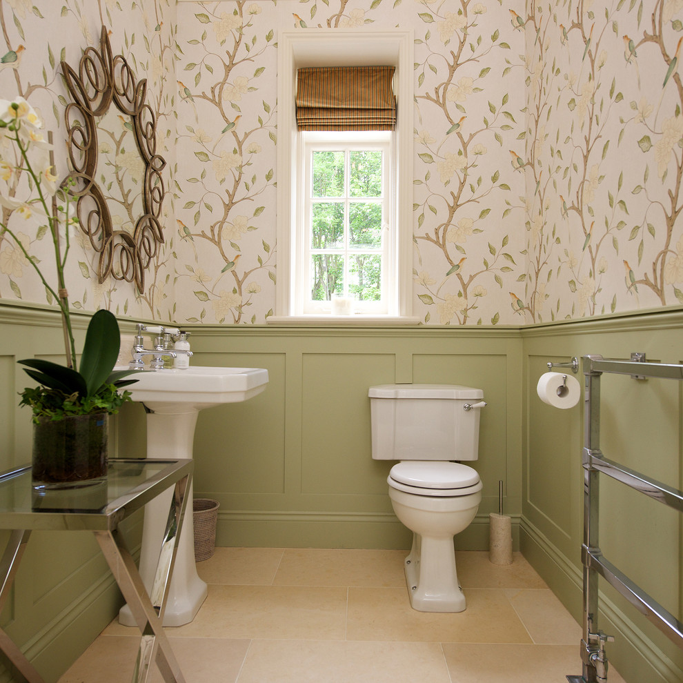 Elegant powder room photo in Other with a pedestal sink, a two-piece toilet and multicolored walls