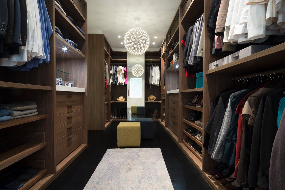 Dressing room - large contemporary gender-neutral dark wood floor and black floor dressing room idea in DC Metro with flat-panel cabinets and medium tone wood cabinets