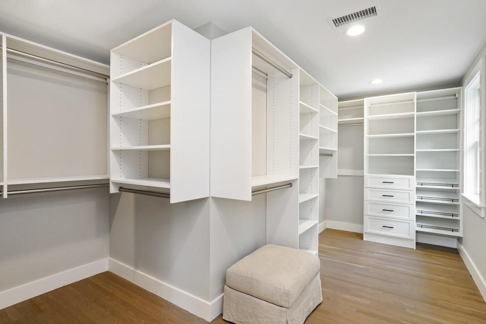 Example of a beach style closet design in Boston