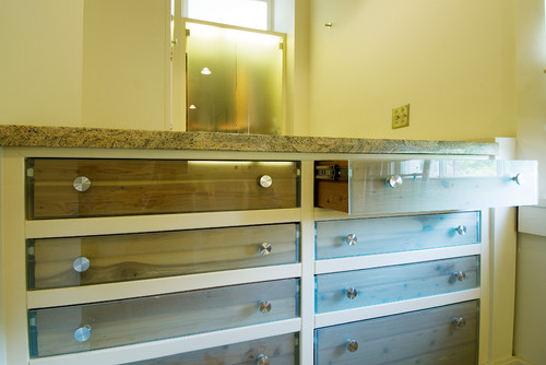 Love the drawer fronts! Glass? Form? I have many hurricane 'slats' left from window replacements ...