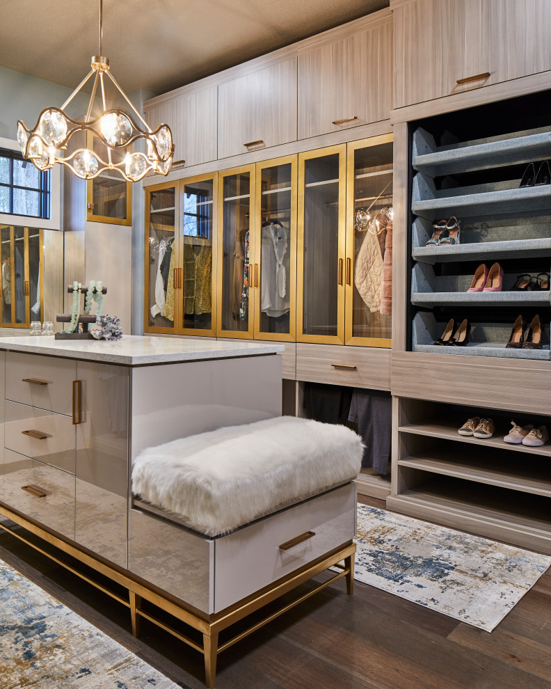 Example of a trendy closet design in Charlotte