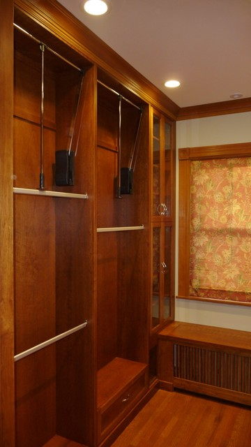 a wood master closet for her traditional-closet