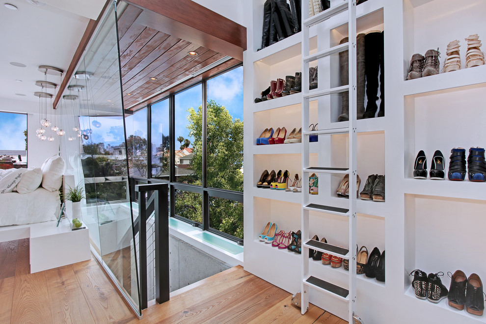 Closet - contemporary light wood floor closet idea in Orange County with open cabinets and white cabinets