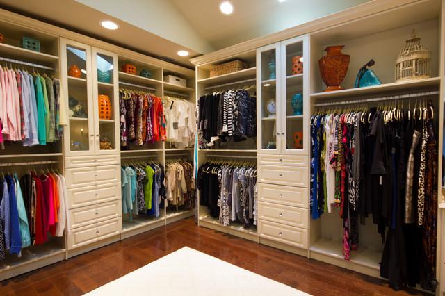 Large Elegant Womenu0027s Dark Wood Floor Walk In Closet Photo In New York With  Raised