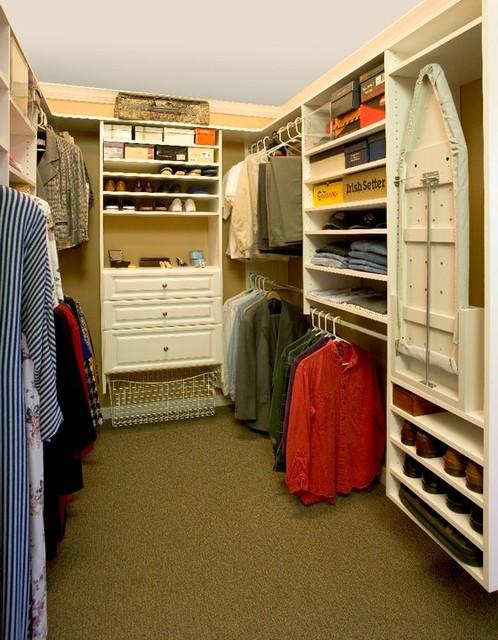 Antique White Walk-In Closet traditional-closet
