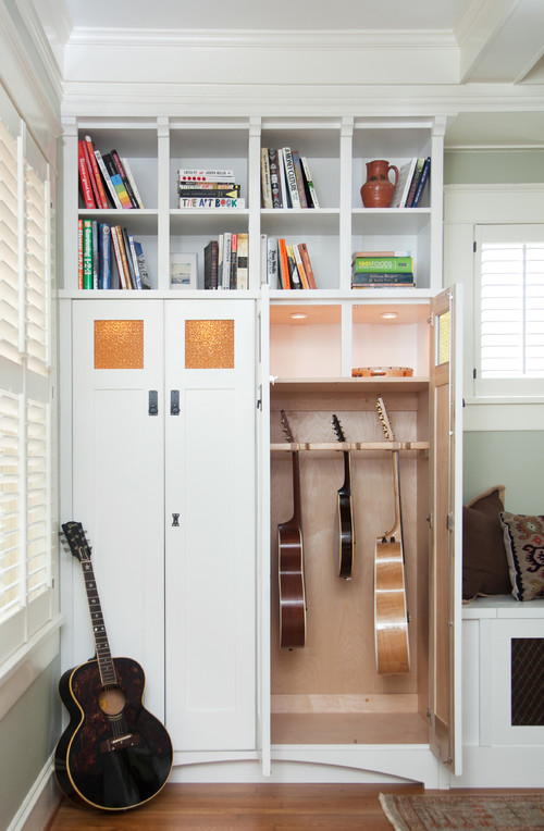 built in cabinetry and guitar storage