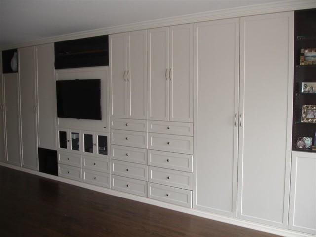 Beautiful Master Closet in White traditional-closet