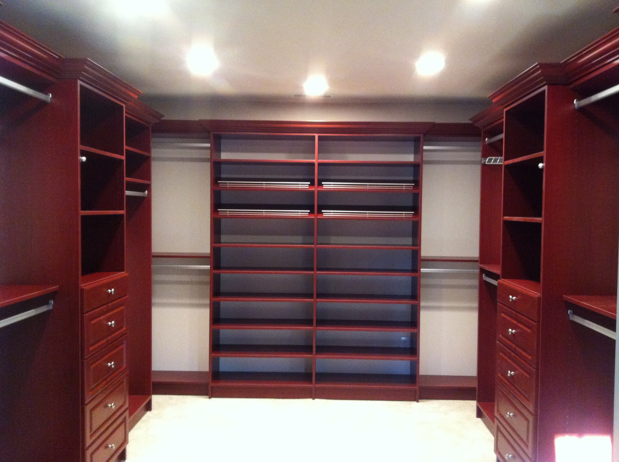 This closet is a cherry wood grain.  The back wall is a shoe wall and flanked by two double hang.