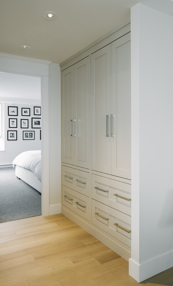 Example of a small transitional light wood floor dressing room design in Vancouver with shaker cabinets and gray cabinets