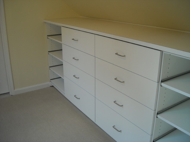 Built in storage drawers with slide out shoe shelves Traditional
