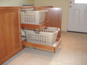 What are the dimensions of this cabinet with the laundry baskets?