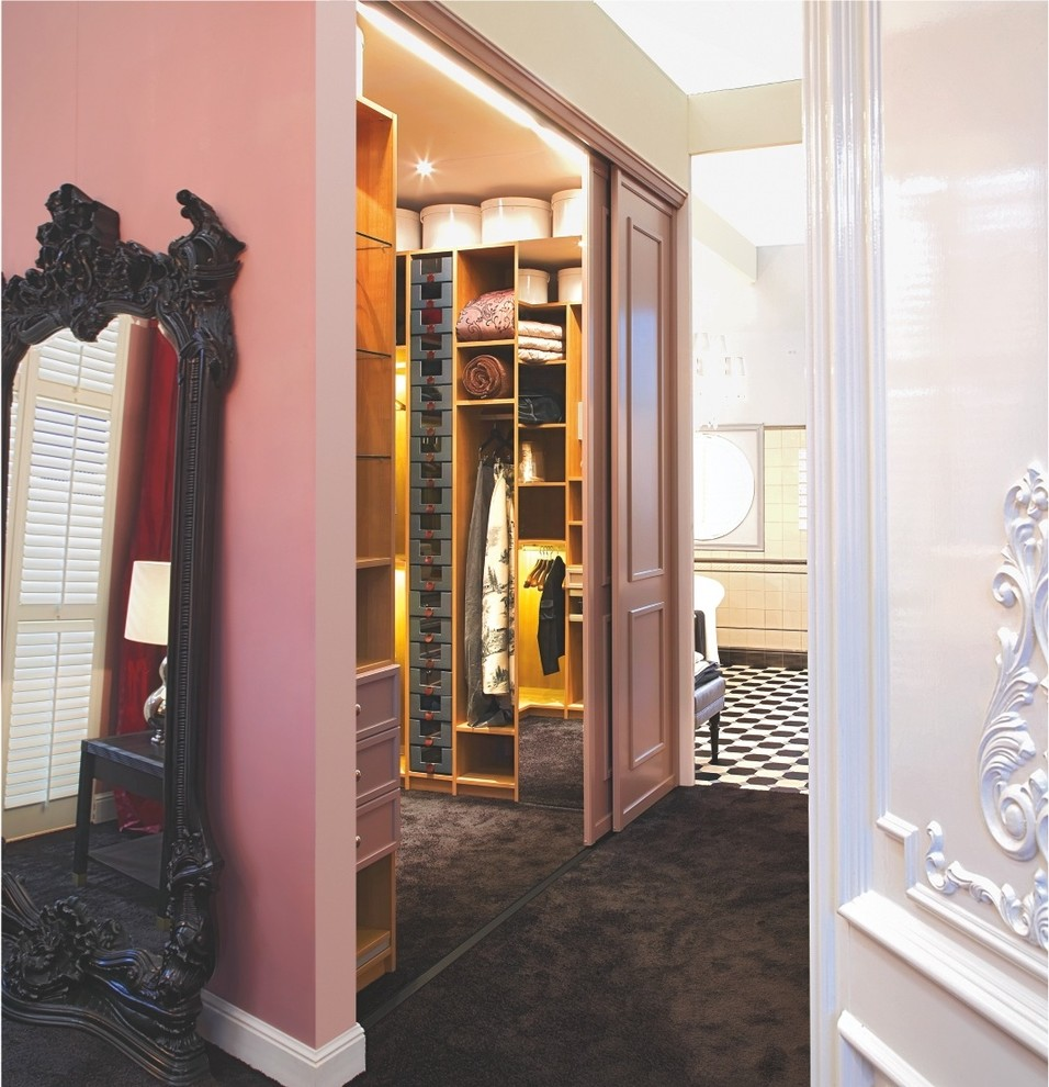 Walk-in closet - mid-sized traditional gender-neutral carpeted walk-in closet idea in Other